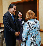 DePaul President A. Gabriel Esteban, Ph.D., and his wife Josephine are greeted by Therese Fauerbach, CEO of The Northridge Group, during a reception with women leaders Thursday, July 20, 2017, at The Chicago Club. The event was organized to welcome the Estebans to Chicago and introduce them to some of Chicago&rsquo;s most influential women.<br />