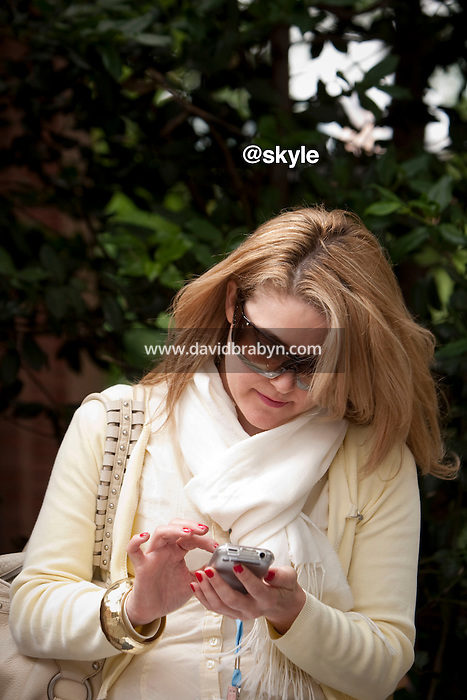 Selina McCusker (@skyle) checks her messages on her smart phone during the 140 Character conference in New York City, USA, 16 June 2009.