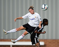 Esther Anyanwu (14) of the Virginia Beach Piranhas collides on a header with Carter Blair (20) of the Fredericksburg Impact during the game at the University of Mary Washington Battleground Stadium in Fredericksburg, VA.   The Virginia Beach Piranhas defeated the Fredericksburg Impact, 2-0, in a weather shortened game.