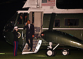 United States President Barack Obama salutes the Marine Guard as he steps off of Marine One on his return to the White House following a day-trip to Osawatomie, Kansas where he discussed the economy, in Washington, DC, Tuesday, December 6, 2011..Credit: Martin Simon / Pool via CNP