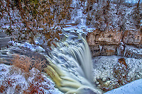 A wintertime view of Spencer Creek running over Webster's Falls.