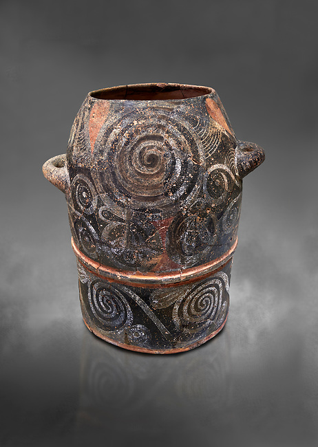 Minoan Kamares Ware with polychrome leaf decorations , Poros-Heraklion 1900-1700 BC; Heraklion Archaeological  Museum, grey background.<br /> <br /> This style of pottery is named afetr Kamares cave where this style of pottery was first found