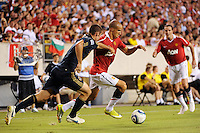 Gabriel Obertan (26) of Manchester United is marked by Andrew Jacobson (8) of the Philadelphia Union. Manchester United (EPL) defeated the Philadelphia Union (MLS) 1-0 during an international friendly at Lincoln Financial Field in Philadelphia, PA, on July 21, 2010.