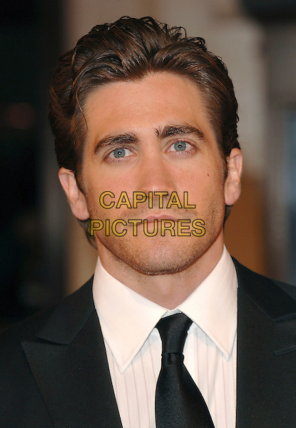 JAKE GYLLENHAAL.Arriving at the 2007 Orange British Academy Film Awards (BAFTAs) at the Royal Opera House, London, England, 11th February 2007..headshot portrait stubble facial hair.CAP/ BEL.©Tom Belcher/Capital Pictures.
