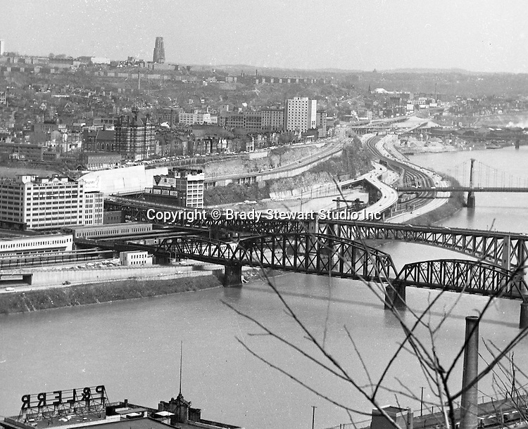 Pittsburgh:  View of Duquesne University and bluff from Mt. Washington - 1962.  View also includes Railroad bridge, Liberty Bridge, Try Street Terminal and University of Pittsburgh in the background.
