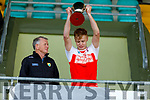 Kenmare/Kilgarvan/Dr Crokes captain Gearoid Fennessy lifts the U21 County Hurling Championship Cup, presented by Paudi Dineen (Co Hurling Officer)
