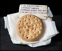 BNPS.co.uk (01202 558833)<br /> Pic: HAldridge/BNPS<br /> <br /> Crumbs...An incredibly rare 104-year-old biscuit that survived the Lusitania disaster is now tipped to sell for £5,000.<br /> <br /> The round hard tack biscuit was found in one of the lifeboats from the Cunard passenger liner after it was torpedoed by a German U-boat in the First World War.<br /> <br /> Almost 1,200 out of 1,962 civilian passengers and crew on board died in the atrocity that sparked outrage on both sides of the Atlantic.<br /> <br /> Sapper Percy Pennington, of the Royal Engineers, was stationed in County Cork, found the snack in a lifeboat and later posted it home to his parents.
