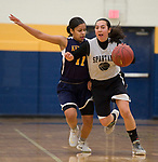 WATERBURY, CT-120818JS10- WCA's Taylor Dunn (10) drives the ball up the court past Kennedy's Shyan Perez (11) while driving to the basket during their Waterbury girls basketball jamboree game Saturday at Kennedy High School. <br /> Jim Shannon Republican American