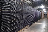 Bottles aging in the cellar. Vallformosa, Vilobi, Penedes, Catalonia, Spain
