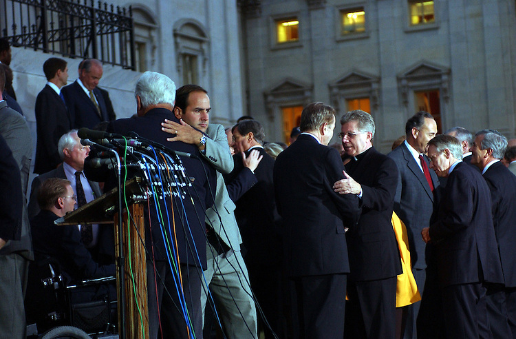 9terrorist091201 -- Speaker of the House J. Dennis Hastert, R-Ill., and Zack Wamp, R-TN., hug after last nights emotional ceremony to show solidarity in denouncing the act of terrorism on America.