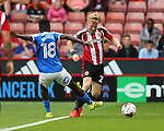 Mark Duffy of Sheffield Utd evades Leo Da-Silva-Lopes of Peterborough Utd  during the League One match at Bramall Lane Stadium, Sheffield. Picture date: September 17th, 2016. Pic Simon Bellis/Sportimage