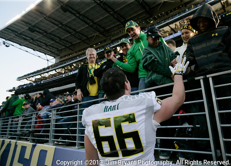 Oregon defensive end Taylor Hart  (66) greets Oregon Duck fans after beating Washington 45-24 in a college football game at Husky Stadium in Seattle, Washington on October 12, 2013.  © 2013. Jim Bryant Photo. All Rights Reserved.