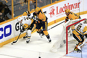 June 11th 2017, Nashville, TN, USA;  Pittsburgh Penguins defenseman Olli Maatta (3) shields the puck from Nashville Predators right wing James Neal (18) during Game 6 of the Stanley Cup Final between the Nashville Predators and the Pittsburgh Penguins, held on June 11, 2017, at Bridgestone Arena in Nashville, Tennessee.