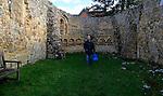 Person inside ruins of Leper Chapel, Dunwich, Suffolk, England, UK