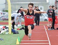 RICK PECK/SPECIAL TO MCDONALD COUNTY PRESS McDonald County Corbin Jones jumps his way to a school record of 43-10.75 to win the triple jump at the Big 8 Conference Track and Field Championships held May 2 at Mount Vernon High School.