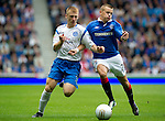 Rangers v St Johnstone....28.08.10  .Liam Caddis battles with Vladimir Weiss.Picture by Graeme Hart..Copyright Perthshire Picture Agency.Tel: 01738 623350  Mobile: 07990 594431