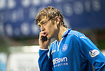 Partick Thistle v St Johnstone....14.12.13    SPFL<br /> Murray Davidson talks on the mobile phone after the game at Firhill was abandoned due to a waterlogged pitch<br /> Picture by Graeme Hart.<br /> Copyright Perthshire Picture Agency<br /> Tel: 01738 623350  Mobile: 07990 594431