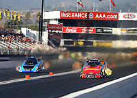 Feb 9, 2018; Pomona, CA, USA; NHRA funny car driver Courtney Force (right) races alongside Jeff Diehl during qualifying for the Winternationals at Auto Club Raceway at Pomona. Mandatory Credit: Mark J. Rebilas-USA TODAY Sports