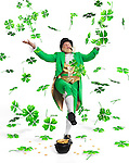 Leprechaun in bright green clothes with a pot full of gold throwing shamrock leaves up in the air. Isolated on white background.