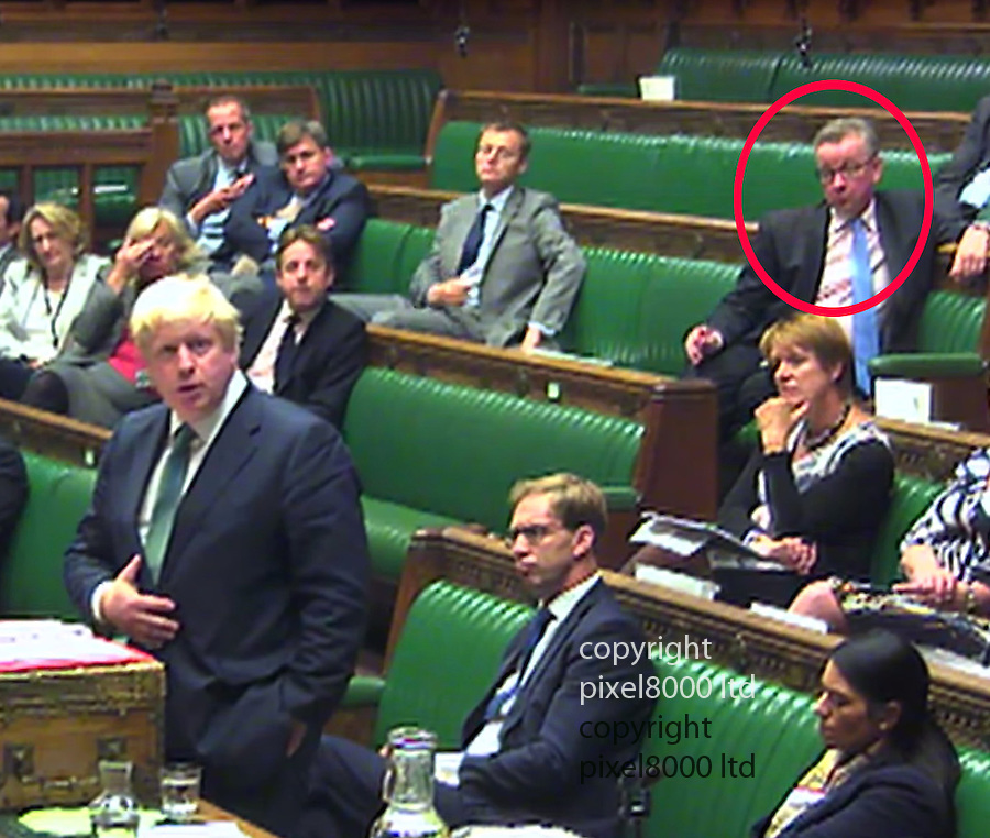 Pic shows<br /> House of Commons debate on Syria <br /> Boris Johnson home secretary calls for demonstrations outside the Russian Embassy in London.<br /> Old friend now foe Michael Gove looks on from behind<br /> <br /> <br /> <br /> <br /> Picture by Pixel 07917221968