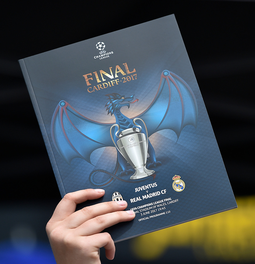 A programme seller holds up the official match programme<br /> <br /> Photographer Kevin Barnes/CameraSport<br /> <br /> UEFA Champions League Final - Juventus v Real Madrid - Saturday 3rd June 2017 - Principality Stadium - Cardiff<br />  <br /> World Copyright &copy; 2017 CameraSport. All rights reserved. 43 Linden Ave. Countesthorpe. Leicester. England. LE8 5PG - Tel: +44 (0) 116 277 4147 - admin@camerasport.com - www.camerasport.com
