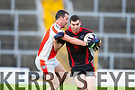 Jeremiah Hoare Glenbeigh-Glencar is tackled by Brosna Shane Curtin during their Junior club championship semi final in Fitzgerald on Saturday