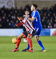 Lincoln City's Matt Green shields the ball from Notts County's Shaun Brisley<br /> <br /> Photographer Andrew Vaughan/CameraSport<br /> <br /> The EFL Sky Bet League Two - Lincoln City v Notts County - Saturday 13th January 2018 - Sincil Bank - Lincoln<br /> <br /> World Copyright &copy; 2018 CameraSport. All rights reserved. 43 Linden Ave. Countesthorpe. Leicester. England. LE8 5PG - Tel: +44 (0) 116 277 4147 - admin@camerasport.com - www.camerasport.com