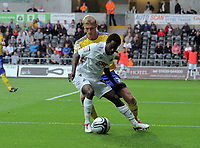 ATTENTION SPORTS PICTURE DESK<br /> Pictured: Nathan Dyer of Swansea (FRONT) closely marked by Dean Moxey of Derby County.<br /> Re: npower Championship, Swansea City Football Club v Derby County at the Liberty Stadium, Swansea, south Wales. Saturday 02 October 2010