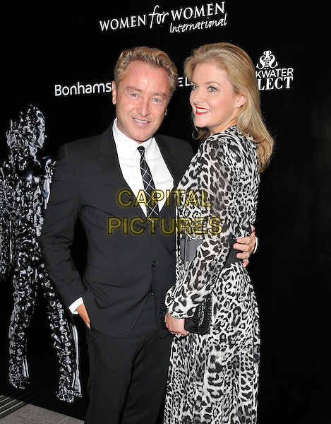 Michael Flatley &amp; Niamh O'Brien attend the Women for Women International &quot;She Inspires Art&quot; Gala, Bonhams, New Bond Street, London, England, UK, on Wednesday 16 September 2015. <br /> CAP/CAN<br /> &copy;Can Nguyen/Capital Pictures