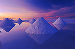 Pyramids of salt reflect the pink hues of predawn light rising above the Salar de Uyuni in the Altiplano of central Bolivia.  The salt flat is one of the largest in the world and a remnant of an ancient lake.