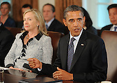 United States President Barack Obama speaks at a Cabinet Meeting as U.S. Secretary of State Hillary Rodham Clinton looks on in the Cabinet Room at the White House in Washington, DC., Monday, October 3, 2011..Credit: Olivier Douliery / Pool via CNP