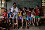 Teacher Lodema Dela Cruz Doroteo teaches children in a class in Santa Ines, an indigenous village in the Philippines. A graduate of Harris Memorial College, where she benefited from a scholarship from United Methodist Women, she is the first indigenous school teacher in her village.