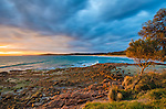 Sunset over Coles Bay in the Freycinet National Park on the east coast of Tasmania in Australia.