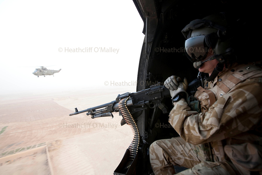 Mcc0027461 . Daily Telegraph..A door gunner on a Royal Navy Sea King helicopter flying over Helmand...Helmand 6 December 2010
