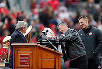 Head coach Urban Meyer carefully returns the crystal football to The Coaches Trophy during the Ohio State football National Championship celebration at Ohio Stadium on Saturday, January 24, 2015. (Columbus Dispatch photo by Jonathan Quilter)