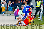 Gavin Crowley Templenoe in action against Eoin O'Shea Éire Óg in the AIB Munster Intermediate Club Football Championship at Ovens.