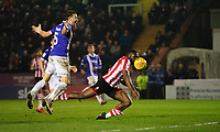 Lincoln City's John Akinde is tackled by Exeter City's Aaron Martin, but his appeal for a penalty was turned down<br /> <br /> Photographer Chris Vaughan/CameraSport<br /> <br /> The EFL Sky Bet League Two - Lincoln City v Exeter City - Tuesday 26th February 2019 - Sincil Bank - Lincoln<br /> <br /> World Copyright © 2019 CameraSport. All rights reserved. 43 Linden Ave. Countesthorpe. Leicester. England. LE8 5PG - Tel: +44 (0) 116 277 4147 - admin@camerasport.com - www.camerasport.com