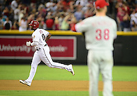 Apr. 23, 2012; Phoenix, AZ, USA; Arizona Diamondbacks outfielder Justin Upton rounds the bases after hitting a solo home run off Philadelphia Phillies pitcher Kyle Kendrick in the fourth inning at Chase Field. Mandatory Credit: Mark J. Rebilas-