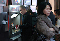 People queue at ATM machines of HSBC bank in Central District, Hong Kong. .