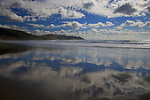 Cloud reflections in the wet sand at Castlepoint.