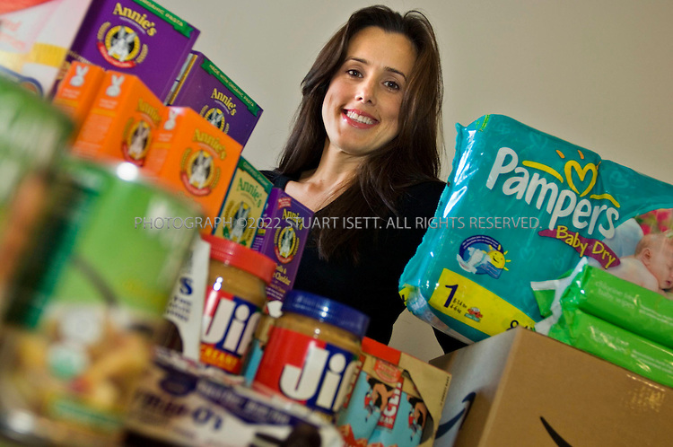 07/20/2006--Seattle, WA, USA..Maria Renz, director of Amazon Consumerables at Amazon.com headquarters posing with some of the product available on the company's online grocery store...Assignment ID: 30026999A..Photograph By Stuart Isett.All photographs ©2006 Stuart Isett.All rights reserved.