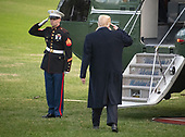 United States President Donald J. Trump salutes the Marine Guard as he boards Marine One after taking questions from reporters as he departs from the South Lawn of the White House in Washington, DC for Florida where he and his family will spend the Thanksgiving holiday on Tuesday, November 20, 2018.  The President took questions about his daughter Ivanka's e-mails, various court cases and Saudi Arabia.<br /> Credit: Ron Sachs / CNP<br /> (RESTRICTION: NO New York or New Jersey Newspapers or newspapers within a 75 mile radius of New York City)