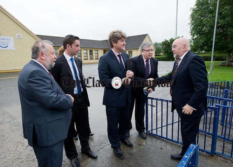 Ruairi Quinn, TD, Minister for Education and Skills, is greeted by Pat Breen TD watched by Councillor John Crowe, school principal Gareth Heagney Michael Mc Namara, TD on his arrival to Sixmilebridge National School. Looking on are;  and Pat Breen, TD. Photograph by John Kelly.