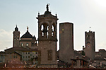 The towers of roofs of Bergamo, Italy at sunset