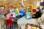 Christopher and Lisa Curran shopping in the Autism friendly Garveys Supervalu pictured with Ciara Finn Garveys.