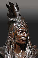 Indian chief, detail of bronze bust, 1885, by Theodore Baur, 1835- after 1902, from the collection of the Denver Art Museum, Denver, Colorado, USA. The chief wears a feather headdress and braids in his hair. Picture by Manuel Cohen