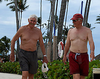 Allison's uncle, Don Steinwehe, and father, Eric Griffiths, walk on the pool deck two days before the wedding