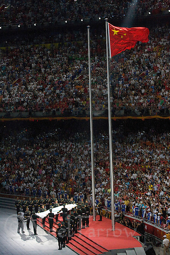08 AUG 2008 - BEIJING, CHN - The Olympic flag is carried to its flag pole during the Opening Ceremony -  Beijing Olympics. (PHOTO (C) NIGEL FARROW) *** IOC RULES APPLY ON USAGE ***