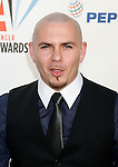 WESTWOOD, CA. - September 17: Singer Pitbull arrives at the 2009 ALMA Awards held at Royce Hall on the UCLA Campus on September 17, 2009 in Los Angeles, California.