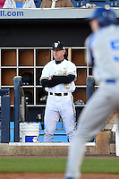 Vanderbilt Commodores head coach Tim Corbin (4) looks on from the dugout during a game against the Indiana State Sycamores on February 20, 2015 at Charlotte Sports Park in Port Charlotte, Florida.  Vanderbilt defeated Indiana State 3-2.  (Mike Janes/Four Seam Images)
